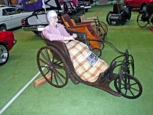 Elder woman in bath chair from 1880s.