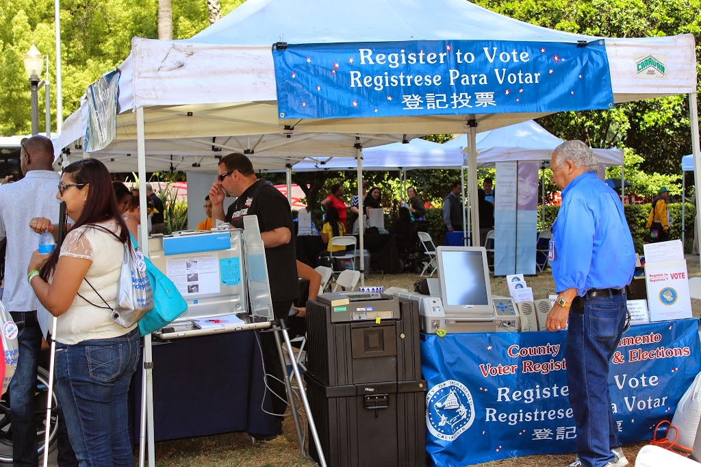 the county of Sacramento voter registration & elections booth displays the new accessible voting machine.