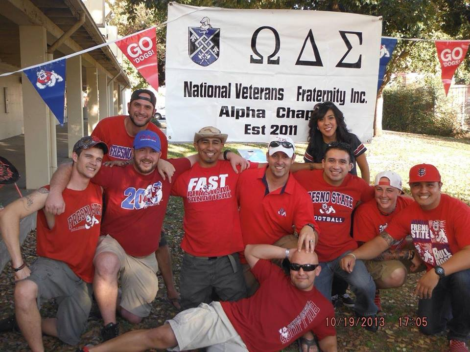Omega Delta Sigma tailgate group photo