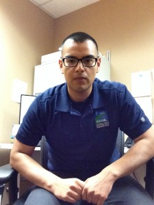 picture of Jorge Ruiz from CCCL wearing a blue polo with CCCIL's logo on it sitting in a chair