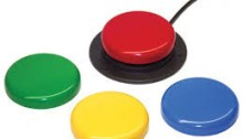 picture of four circlular switches, red green, yellow and blue and the red is attached to a black cord