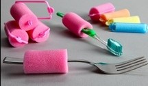 pink hari rollers used as grips for toothbrush and fork