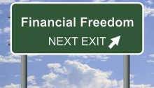 "Picture of street sign that says ""financial Freedom next exit"""