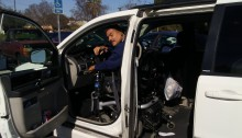 picture of gentlamen in modified white van using hadn controls