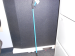 reacher grabber picture - blue and standing against the wall