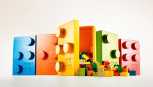 Photo of colorful Braille Bricks boxes with the Braille Brick lego's falling out.