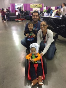 Photo of family with son using the ZipZac mobility Device