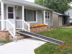 Portable Ramp extending from house front porch