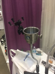 A mounting system for a wheelchair user that has a cup and cell phone holder attached