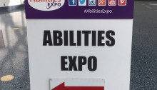 Directional sign in convention center with big red arrow pointing towards the Expo