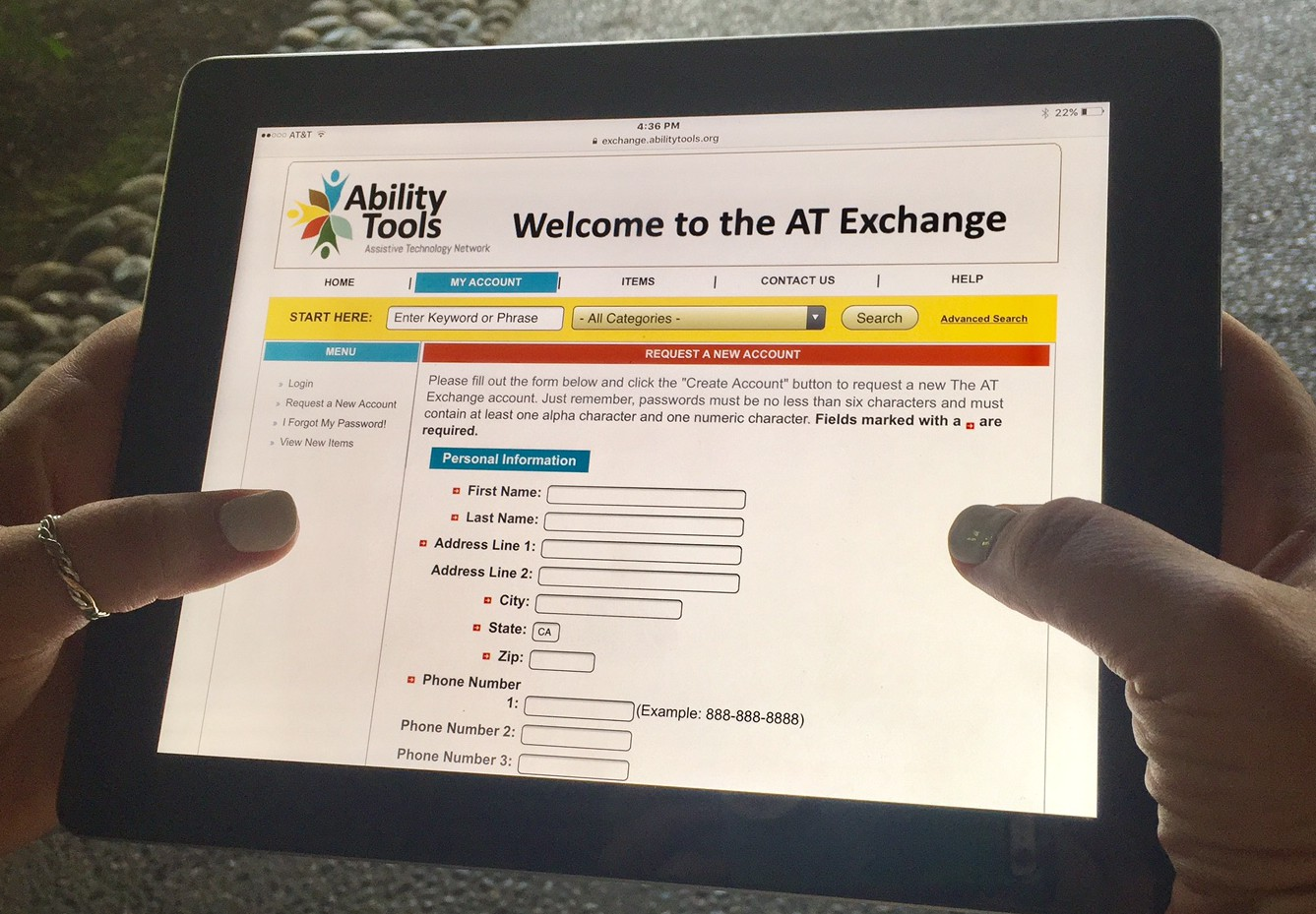 "hands holding up an ipad displaying the ""AT Exchange new account"" page"