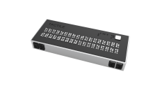 black rectangular device with many retractable white pins on top