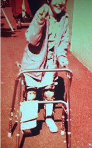 Christine as child using a walker with leg braces