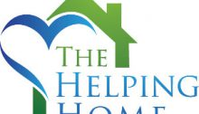 The helping home logo that have a green house over green and blue writing with a heart Incorporated in