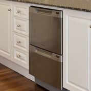 There are two stacked dishwasher drawers built in to the cabinets.