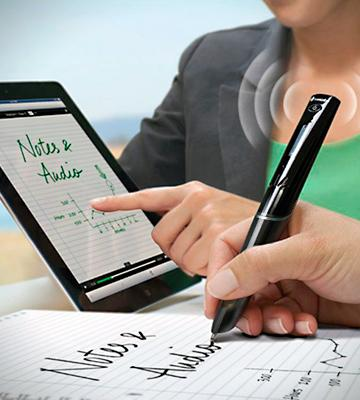 A person is writing with a smart pen, the text they are writing appears on a tablet screen.