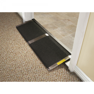 A black and aluminum threshold ramp in shown in a door way.