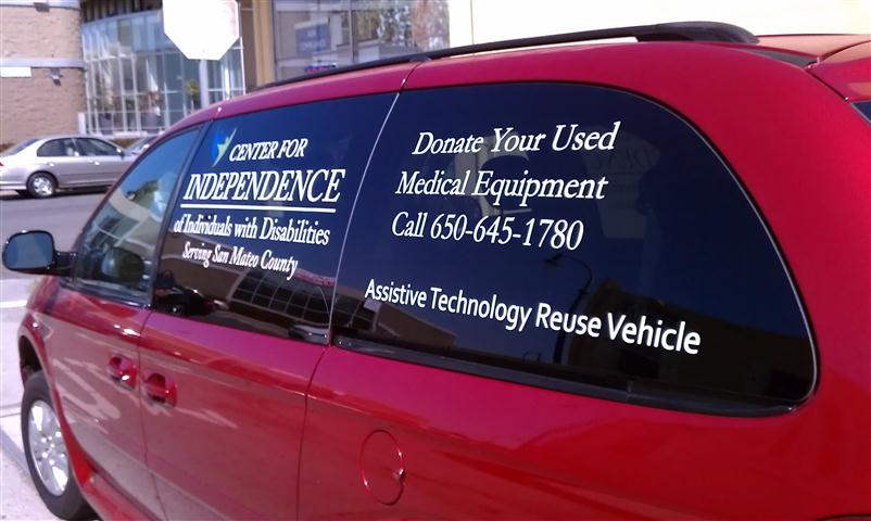 A photo of the CID van with contact information for their Reuse Program on the windows""