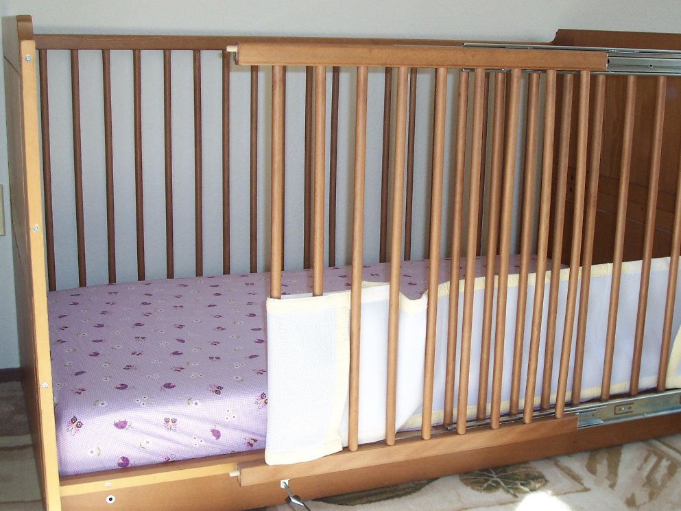 Picture of wooden crib with modified sliding door