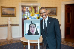 President Barack Obama greets Alice Wong, Disability Visibility Project Founder, via robot, during the Americans with Disabilities Act 25th Anniversary reception in the Blue Room of the White House, July 20, 2015