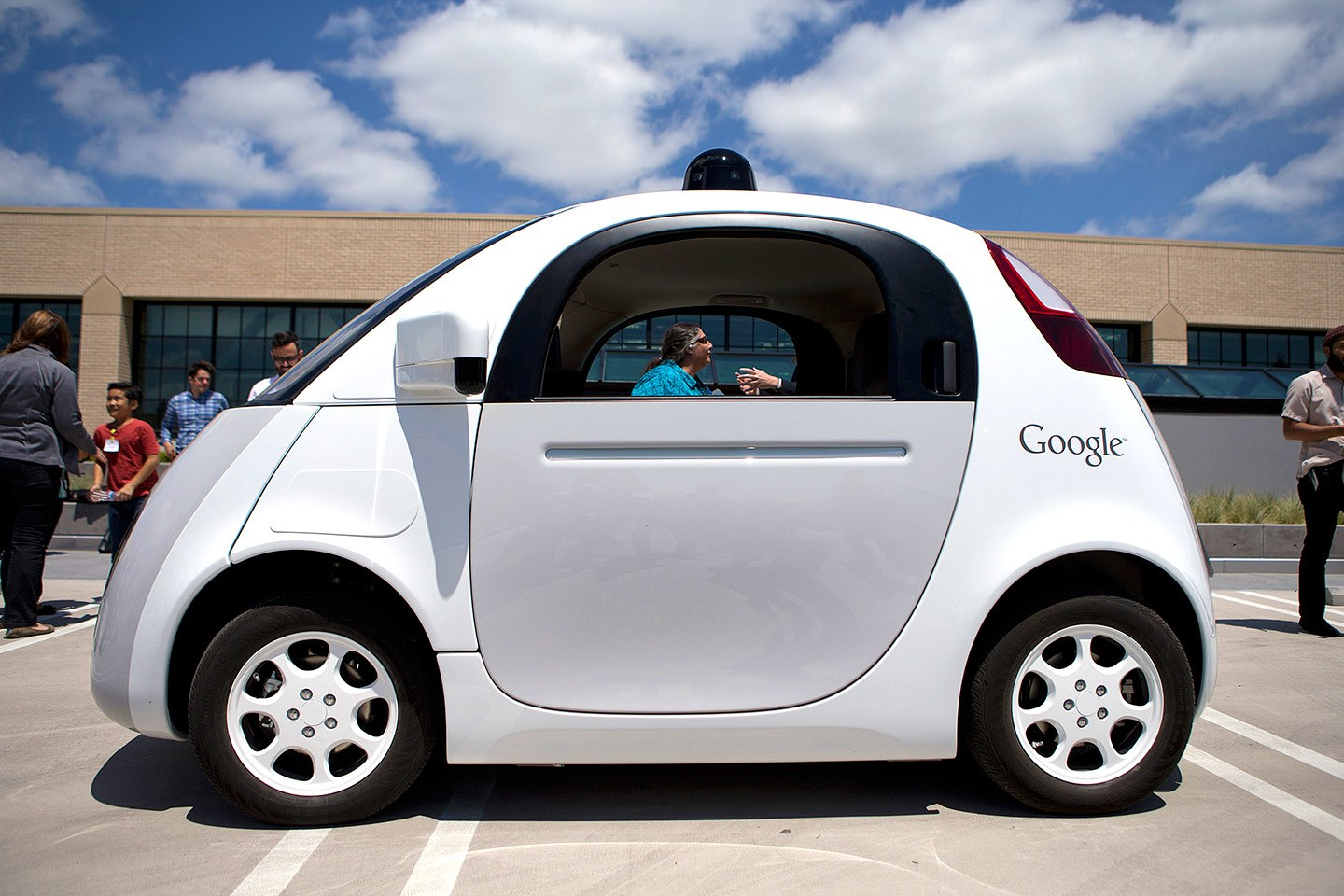 A picture of a white Google self-driving car. CFILC''s former Executive Director, Teresa, can be seen through the window of the car.