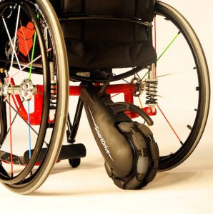 wheelchair with a power assist motorized wheel attached to the back with 'smartdrive' printed on it