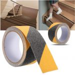 Black and yellow contrasting tape with a photo of where to apply it on stairs.