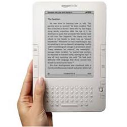 Photo of a hand holding a white tablet device with a simple screen and buttons.