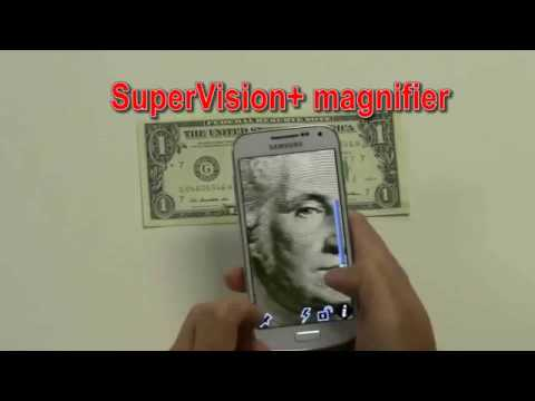 Photo of a person taking a cell phone photo of a dollar bill. The phone screen shows a large image of Washington's face.