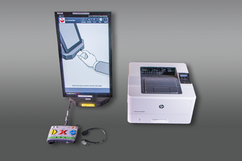 A Dominion ICX touchscreen voting machine with assistive technology input device and headphones.