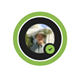 """A Teams profile bubble with a green ring around it with the """"Available""""  icon in the bottom right corner.  The profile picture contains a man from the chest up, wearing a hat and a button up shirt, standing in front of the capitol."""