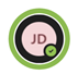 """A Teams profile bubble with a green ring around it with the """"Available""""  icon in the bottom right corner.  The profile picture contains the initials JD."""