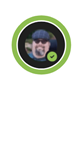 """A Teams profile bubble with a green ring around it with the """"Available""""  icon in the bottom right corner.  The profile picture contains a close up of a man with a goatee, cap and sunglasses."""