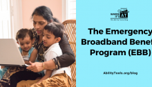 A woman gathers tightly with two small children in a chair, while the group works with a laptop. The Where it's AT logo is situated above the text. Text reads: The Emergency Broadband Benefit Program (EBB) - AbilityTools.org/blog