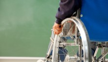 back view of individual in a manual wheelchair