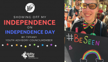 "A black background with a photo of the author at Pride. There is the YO! Disabled and Proud logo. The text reads ""Showing off my Independence on Independence Day By: Tiffany Youth Advisory Councilmember"". Beneath this are rainbow stars and the Ability Tools Logo."
