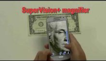 Hands holding SmartPhone to take a photo of a one dollar bill. Text: SuperVision+ Magnifier