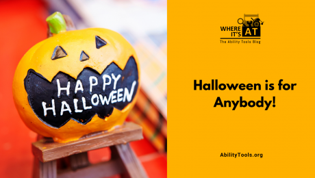 """A toy jack-o-lantern with the phrase """"Happy Halloween"""" printed in it's open mouth. Under the Where it's AT logo, the text reads """"Halloween is for anybody!"""" - abilitytools.org"""